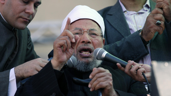 Egyptian cleric Sheik Youssef el-Qaradawi speaks to the crowd as he leads Friday prayers in Tahrir Square in Cairo, Egypt, Friday Feb. 18, 2011.