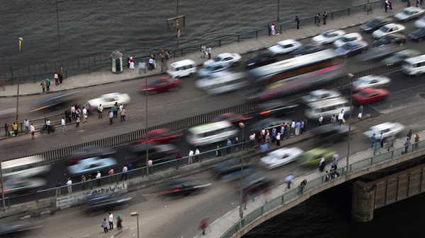 Egyptians commute in heavy and mostly unregulated vehicle traffic in Cairo, Egypt.