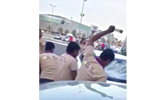 A YouTube grab shows expat workers smashing the car of a Saudi customer following an argument in Dammam.