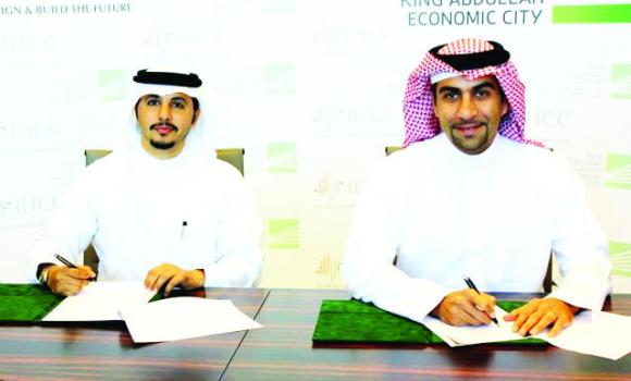Fahd Al-Rasheed, group CEO and MD of KAEC and Sultan Batterjee, CEO of IHCC, sign the contract.