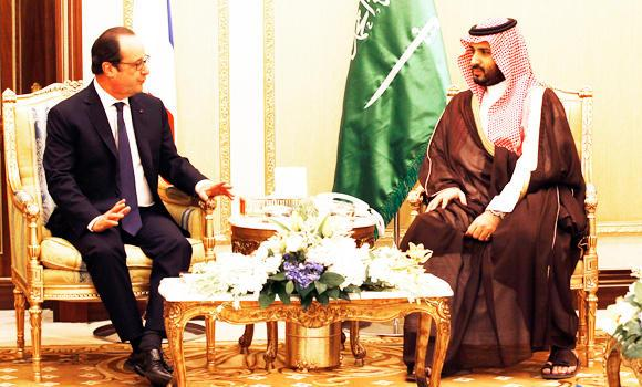 French President Francois Hollande, left, talks with Saudi Arabia's Deputy Crown and Defense Minister Prince Moahmmed bin Salman, during a meeting in Riyadh, Saudi Arabia, on Tuesday.