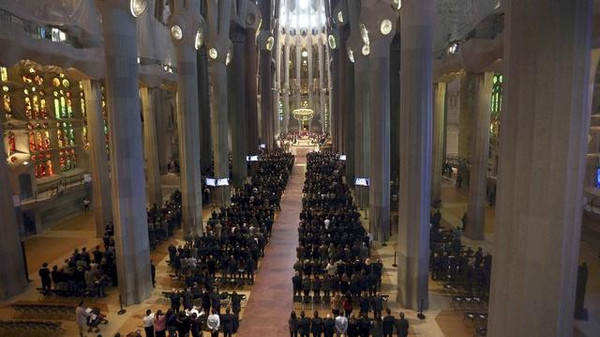 People attend a memorial service for the 150 victims of Germanwings flight 4U 9525 at Sagrada Familia Cathedral in Barcelona.