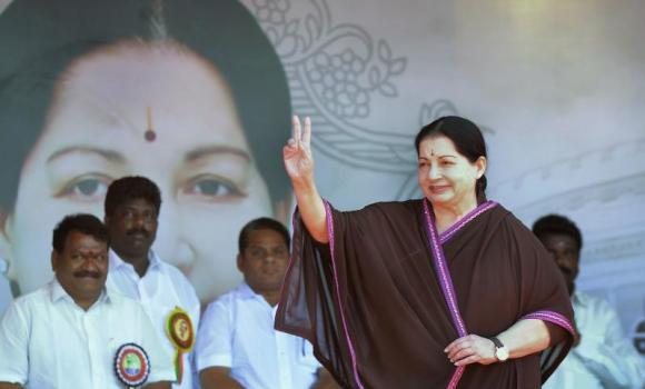 All India Anna Dravida Munnetra Kazhagam (AIADMK) Leader and Chief Minister of the southern Indian state of Tamil Nadu J. Jayalalithaa gestures as she arrives at a recent public meeting in Pondicherry.