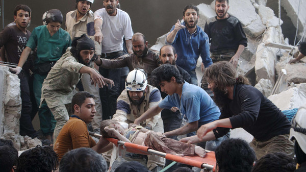 U.N. envoy to Syria condemned Assad's regime's use of barrel bombs after deaths in Aleppo.