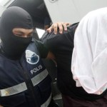 Teenager among six charged in Malaysia over terror plots
