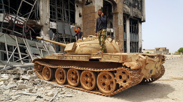 Members of the Libyan pro-government forces stand on a tank in Benghazi, Libya, May 21, 2015.