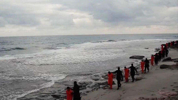 Militants in Libya claiming loyalty to ISIS purportedly shows Egyptian Coptic Christians in orange jumpsuits being led along a beach, each accompanied by a masked militant.