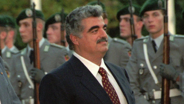 German Chancellor Helmut Kohl, left, and the Prime Minister of Lebanon Rafic Hariri review the honour guards after Hariri's arrival in Bonn Chancellory Tuesday, October 10, 1995.