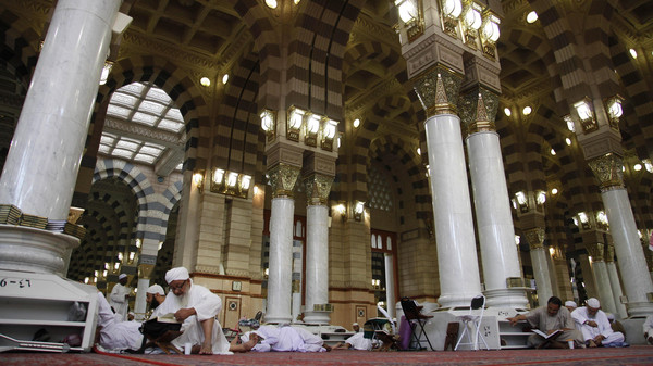 Worshippers read Islam's holy book Quran at the Prophet Mohammad's Mosque in Medinah city in Saudi Arabia, Saturday, July 6, 2013.