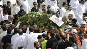Shi'ite Muslims carry the coffin of a Saudi man killed in last Friday blast, during his funeral at Qatif