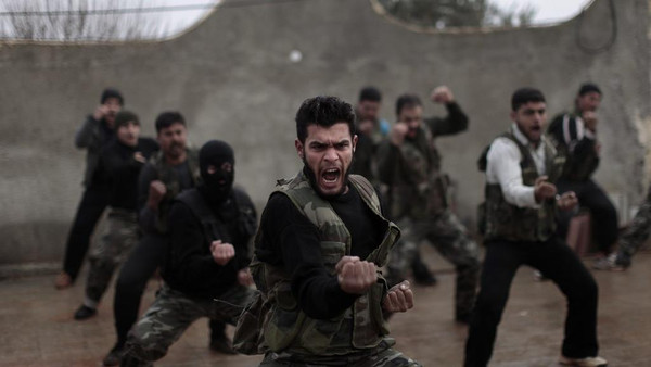 Syrian rebels attend a training session in Maaret Ikhwan, near Idlib, Syria, in December 2012.