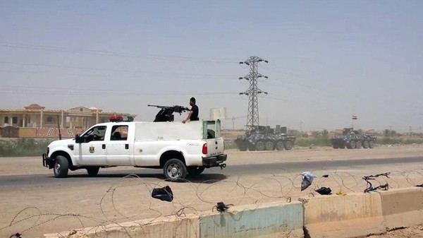 Arriving from Baghdad, federal police forces create a barricade to protect the Habaniyah military base near Ramadi, Iraq, in eastern Husaybah town, 8 kilometers (5 miles) east of Ramadi on Monday, May 18, 2015.