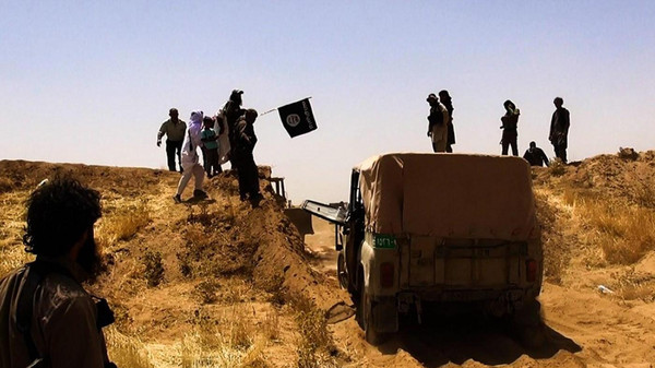 The Islamic State of Iraq and Syria (ISIS) seized the Iraqi side of a key border crossing with Syria after isolated government forces pulled out.