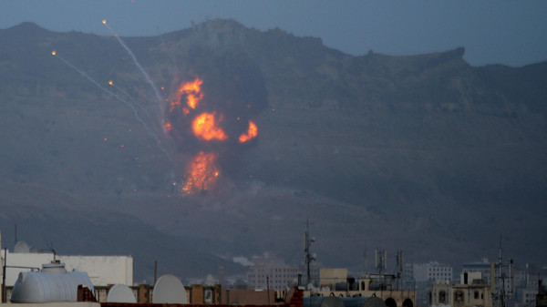 An explosion is seen from the Noqum Mountain after it was hit by an air strike in Yemen's capital Sanaa.