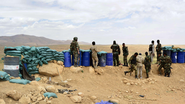 Syrian regime seized control of several hilltops in the mountainous area that straddles the Syria-Lebanon border with the support of Lebanon's Hezbollah movement.