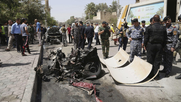 The aftermath of a car bomb that detonated in Baghdad on May 5, 2015