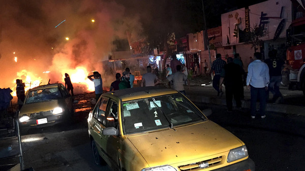 A file photo shows people gathering at the site of a car bomb attack in Baghdad earlier this month.