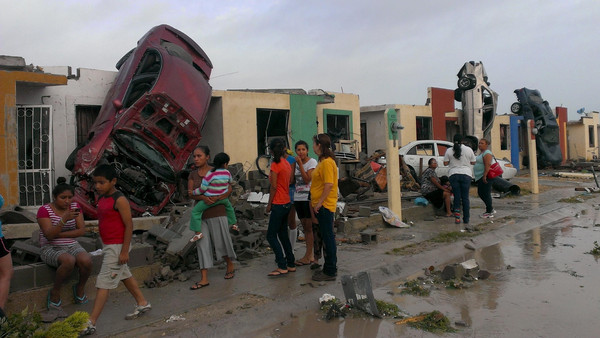 At least 13 have been confirmed dead after a tornado raged through a city on the U.S.-border with Mexico.