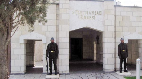 Turkish soldiers stand guard at the entrance of the memorial site of Suleyman Shah, grandfather of Osman I, founder of the Ottoman Empire, in Karakozak village, northeast of Aleppo, Syria.