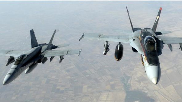 The U.S.-led military coalition launched 12 air strikes in Iraq and one in Syria against Islamic State of Iraq and Syria (ISIS) militants since Monday.