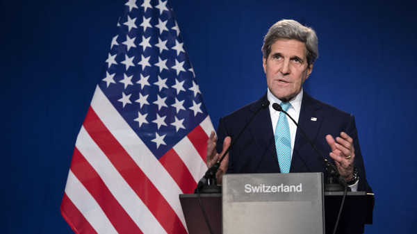 US Secretary of State John Kerry gestures as he speaks to the press at the Swiss Federal Institute of Technology, or Ecole Polytechnique Federale De Lausanne, in Lausanne, Switzerland, Thursday, April 2, 2015.