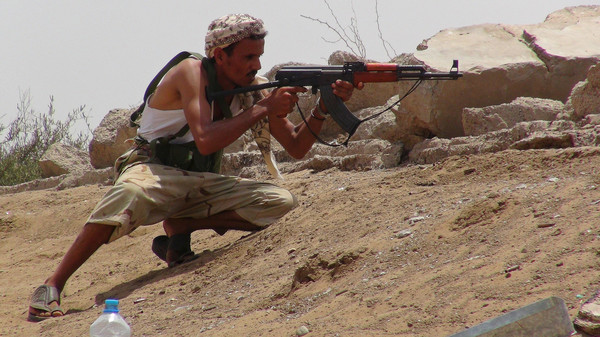 A fighter from the Southern Popular Resistance takes up position at a front line against Houthi fighters in the Bir Ahmad outskirts of Aden, Yemen.
