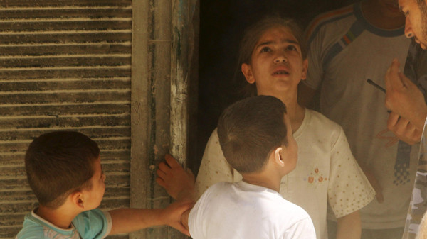A girl reacts at a site hit by what activists said was a barrel bomb dropped by forces loyal to Syria's President Bashar al-Assad in al-Kalaseh neighbourhood of Aleppo, Syria.