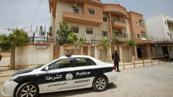 A police vehicle is seen parked in front of the Tunisian consulate in Tripoli, Libya June 13, 2015.
