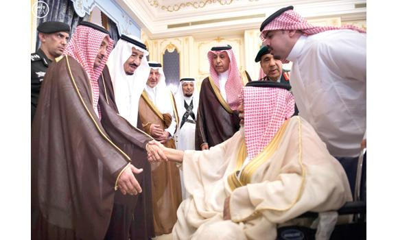 Custodian of the Two Holy Mosques King Salman meets an elderly visitor while receiving princes, religious scholars and a group of citizens who came to offer him Ramadan greetings at Al-Salam Palace in Jeddah on Tuesday. (SPA)