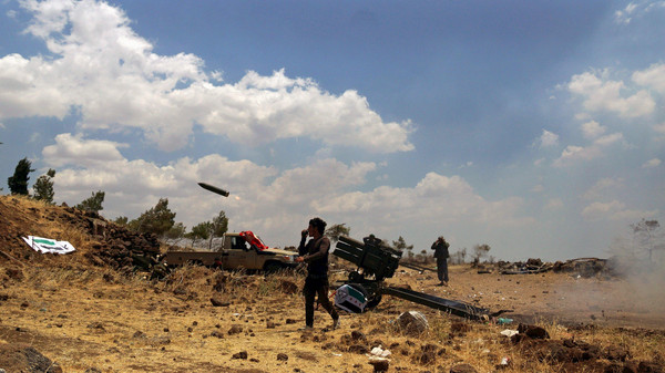 Free Syrian Army fighters fire rockets towards forces loyal to Syria's President Bashar al-Assad in the northern countryside of Quneitra, Syria, June 17, 2015.