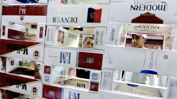 Egyptians buy imported cigarettes at a popular market in Cairo, Egypt.