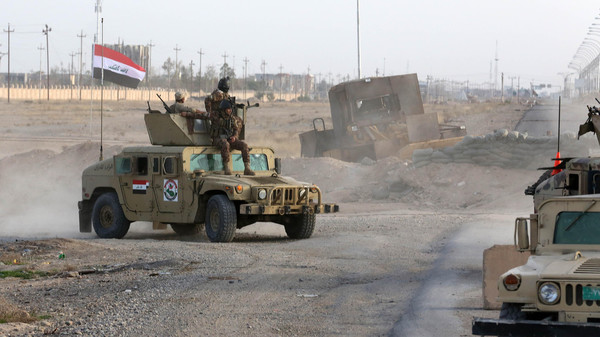 Iraqi forces have tried to recapture the strategic town near Iraq's largest oil refinery last year with no success.