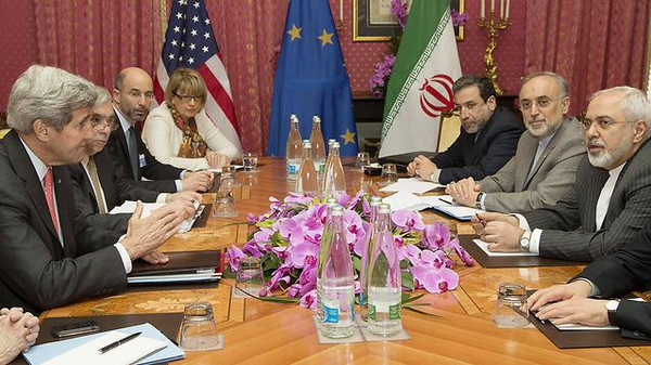 U.S. and Iranian officials on the negotiation table.