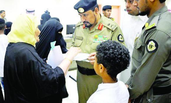 Maj. Gen. Jamaan Al-Ghamdi, assistant director general for security affairs, listens to a Yemeni woman at a correction center in Jeddah.