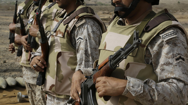 In this photo taken on April 20, 2015, Saudi soldiers with their weapons stand guard at the Yemen border in Jizan, Saudi Arabia.