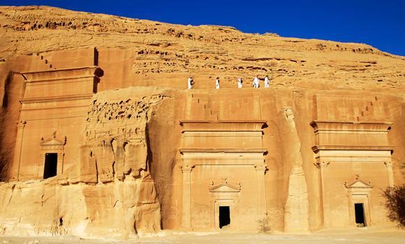 In this May 10, 2012 file photo, Saudi tourists visit the Qasr al-Bint tombs complex in the desert archaeological site of Madain Saleh, in Al Ula city, 1043 km northwest of the capital Riyadh, Saudi Arabia.