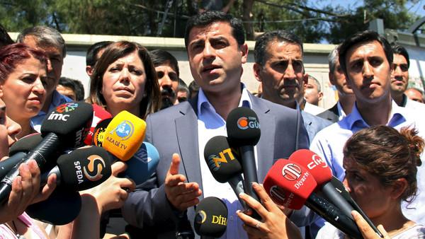 Selahattin Demirtas (C), co-leader of pro-Kurdish Peoples' Democratic Party (HDP), talks to the media in Diyarbakir, Turkey, June 12, 2015.