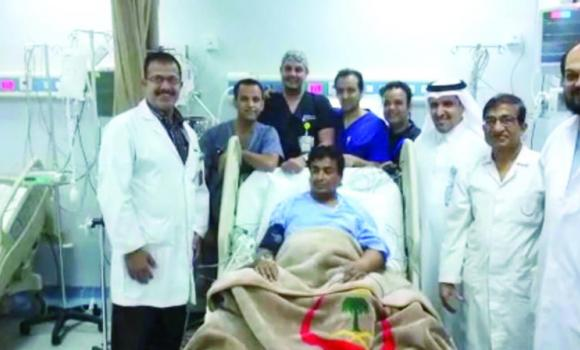 The surgical team in Najran poses with the man on which they performed surgery to remove a piece of shrapnel in his chest.