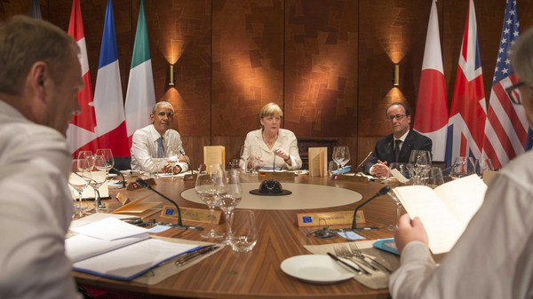U.S. President Barack Obama, Germany's Chancellor Angela Merkel and France's President Francois Hollande (L-R) attend a working dinner at a G7 summit at the hotel castle Elmau in Kruen, Germany, June 7, 2015.