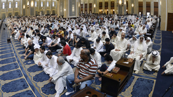 Thousands of Shiite and Sunni worshippers held a rare joint prayer at the Grand Mosque, Kuwait's largest place of worship for Sunnis.