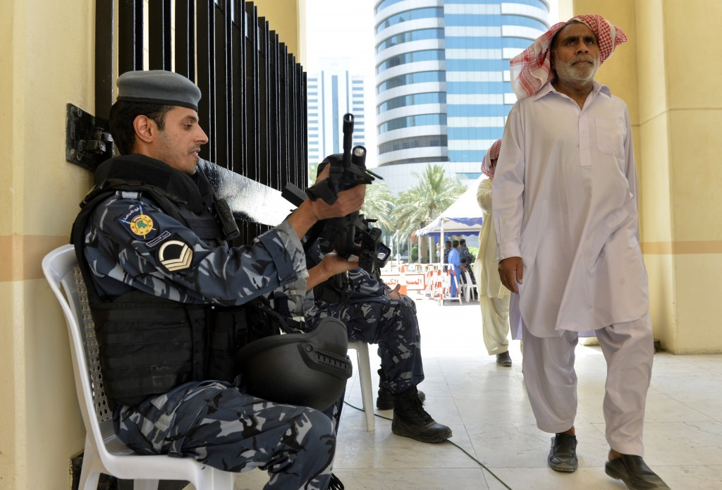 Kuwaiti police guard as worshippers arrive for joint Sunni-Shiite Friday prayers.