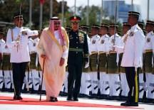 Saudi Arabia's King Salman inspects an honor guard at the Parliament House in Kuala Lumpur on February 26, 2017.