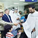 Pilgrims greeted with flowers, sweets — and health advice