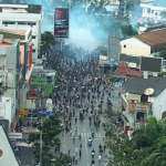 Indonesia arrests dozens for Papua protests that set buildings afire