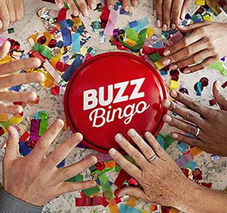 Buzz Bingo buzzer with hands ready to press it