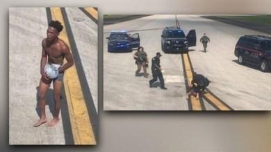 Photo of بالفيديو: لحظة القبض على شاب تسلق جناح طائرة