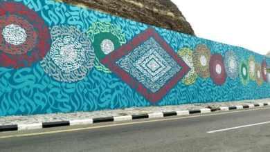 Photo of صور: الانتهاء من أكبر جدارية باللغة العربية في رجال ألمع
