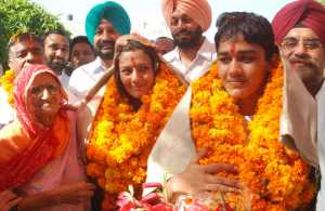 real geeta babita after winning medal