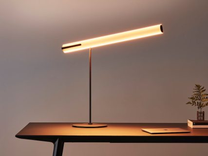 A desk lamp with a comfortable character