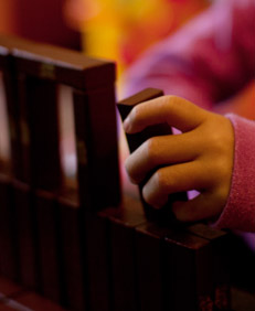 A child's hands playing with blocks